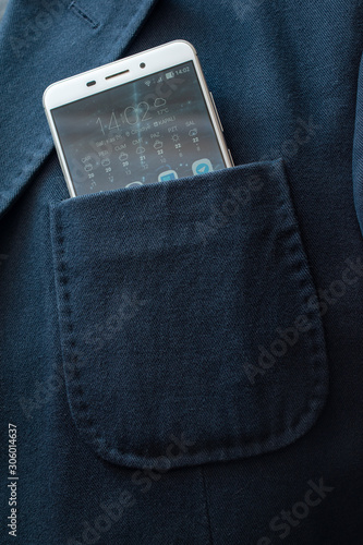 Fotomural Blue jacket chest pocket with a white mobile phone
