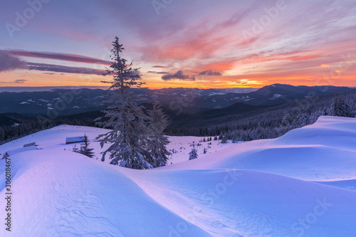 Foto auf AluDibond Flieder Colorful winter dawn on the mountain valleys in the Ukrainian Carpathian Mountains.