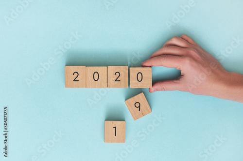 Fototapeta Wooden cubes year 2019 change to 2020. obraz na płótnie
