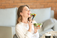 Woman Eating Healthy Vegetable Salad In Office