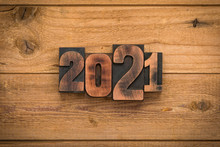 Year 2021, Numbers Written With Vintage Letterpress Printing Blocks On Wood Backgroiund