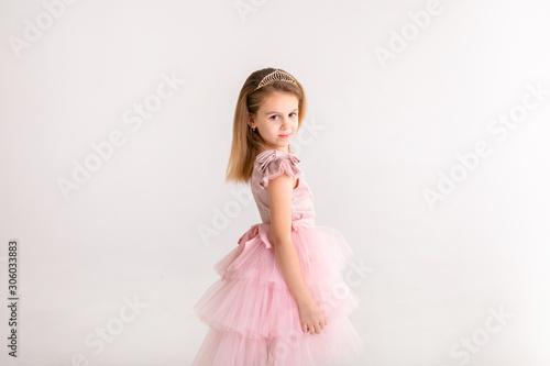 Fotografija  Beautiful little princess dancing in luxury pink dress