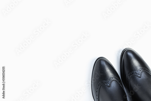 Photo  Close up of women's black leather chelsea boots on white background with reflection