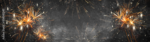 Silvester background banner panorama long- firework on rustic dark black grey stone concrete texture, top view with space for text - 306041245