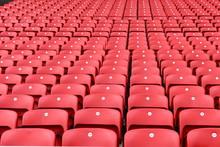 Red Plastic Seats In A Stadium...