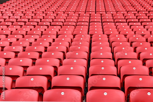 Red plastic seats in a stadium Canvas Print