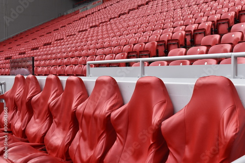 Empty red leather and plastic seats Canvas Print