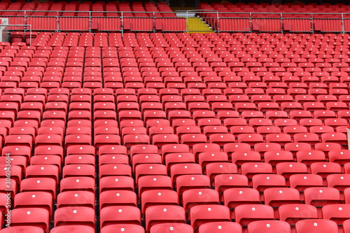 Photo  Red plastic seats in a stadium