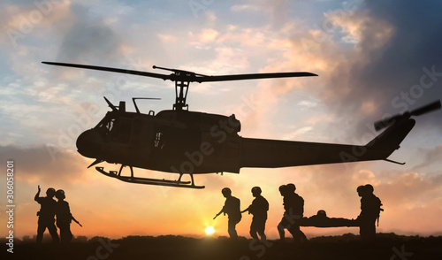 Leinwand Poster Military rescue helicopter during sunset