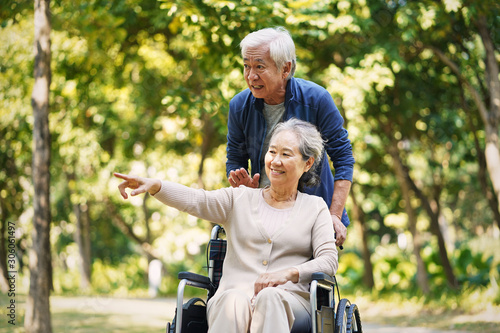 asian senior couple relaxing in park Wallpaper Mural