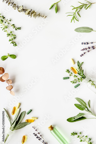 Fototapeta Apothecary of natural wellness and self-care. Herbs and medicine on white background top view frame copy space obraz