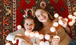 canvas print picture Happy family mother and child daughter with Christmas   garland