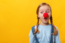 Funny Child Clown With A Red N...