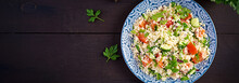Traditional Lebanese Salad Tabbouleh. Couscous With Parsley, Tomato, Cucumber, Lemon And Olive Oil. Middle Eastern Cuisine. Top View, Banner