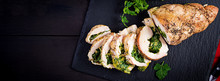Roasted Sliced Christmas Roll Of Turkey With Spinach And Cheese On Dark Rustic Background. Top View, Copy Space. Banner. Festival Food.