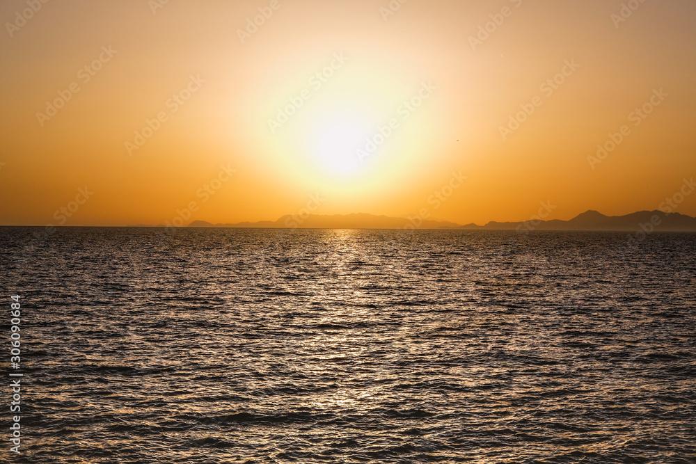 Vivid orange sunset at the sea.