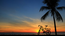 Silhouette Vintage Bike On Sun...