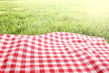 Picnic Cloth On Green Grass Ba...
