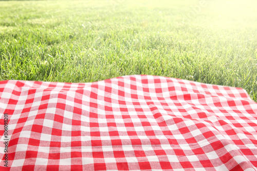 Picnic cloth on green grass background empty space. Canvas