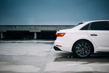Modern Sedan Car Silhouette At The Parking