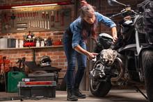 Woman Mechanic Working On A Vi...