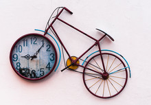 Vintage Bicycle Shaped Wall Clock Hanging On The Wall.