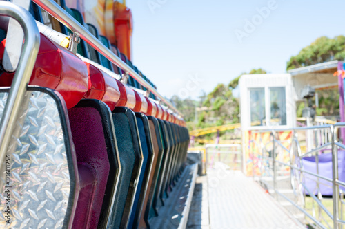 row of coloured chairs in park
