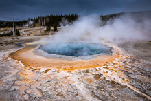 Blue And Orange Geyser Basin With Boiling Water From Geothermal Heat.