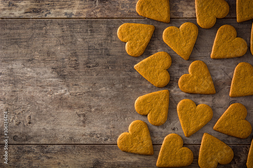 Heart shaped cookie on wooden table Canvas Print