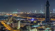 Aerial view of the rhythm illuminated city with lights of Dubai aerial timelapse