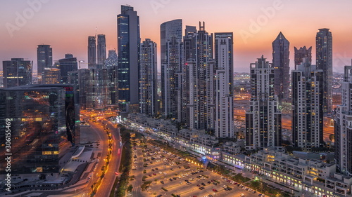 Modern residential and office complex with many towers aerial day to night timelapse at Business Bay, Dubai, UAE Tapéta, Fotótapéta
