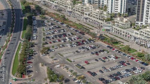 Fototapeta Aerial view full cars at large outdoor parking lots timelapse in Dubai, UAE. obraz