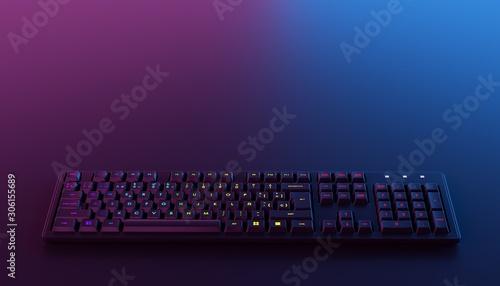 RGB gaming keyboard backlit on dark background. Canvas Print