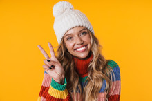 Image Of Joyful Woman In Winter Hat Laughing And Showing Peace Fingers
