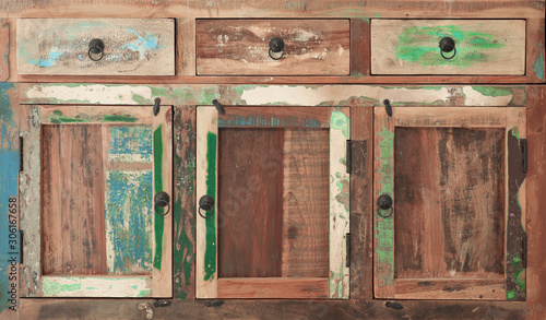 An old wooden multi-colored cupboard as background