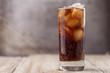 Leinwandbild Motiv Cola with Ice Cubes. Glass of cola with ice cubes on wood table, soft drink. Copy Space.