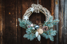 Christmas Wreath On Rustic Woo...