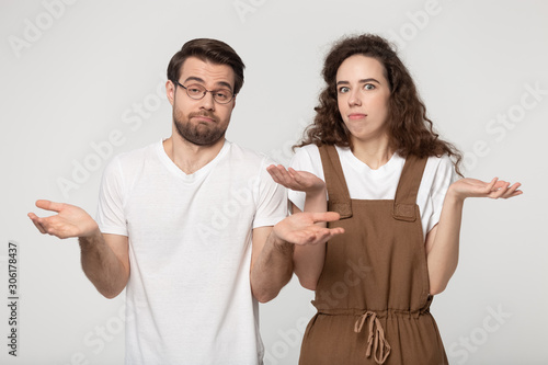 Confused millennial couple shrug shoulders feel baffled Canvas Print