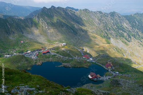 Fototapeta Panorama from 2000 meters altitude where you can see Bâlea Lac, Bâlea Lac chalet and Transfăgărășan road. Picture taken on 03.09.2019. obraz na płótnie