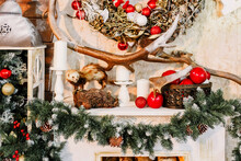 .New Year 2020. Christmas Beautiful Lights On Gold Warm Background. Christmas Tree, Toys. Photo Of Interior Of Room With A Wooden Wall, Wreath And Garlands, Fireplace With Firewood.