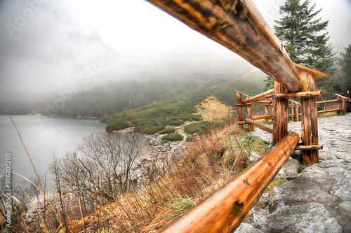 Foto auf Leinwand Khaki Tatra National Park in Polish High Tatra Mountains. Lake Morskie Oko (Eye of the Sea Lake) on a foggy and rainy day, Zakopane, Poland, Europe.