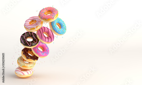 Vászonkép Donuts in motion falling on white background