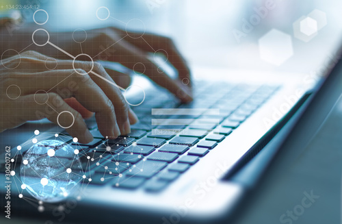 Fotomural  businesswoman hand working with modern technology and digital layer effect as business strategy concept