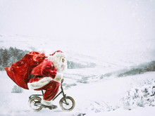 Santa Claus On A Little Bike O...