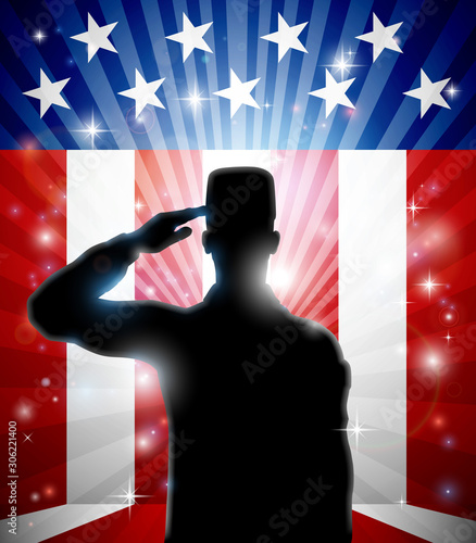 Canvas Prints Military A patriotic soldier standing saluting in front of an American flag background