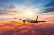 canvas print picture - Passengers commercial airplane flying above clouds