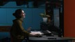 Slowmotion happy office worker sitting at desk in modern workspace late at night dancing with headphones / active student evening working, dancing listening to music with headphones, blue background