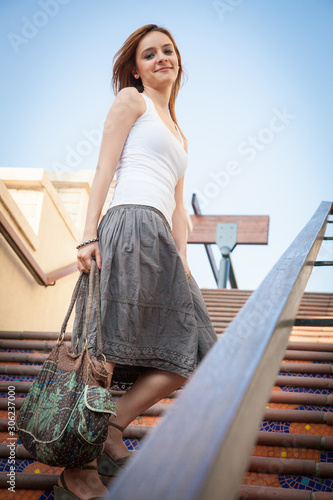 young woman standing on stairs Canvas Print