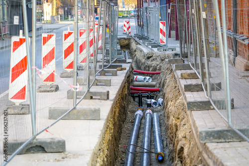 Fototapeta replacement of underground district heating pipes on city street obraz