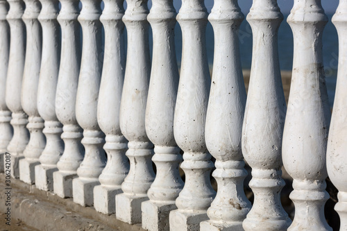 Photo White, decorative fence with balusters.